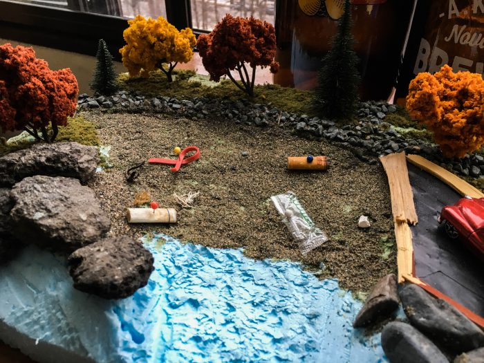 A model representation of Black Rock Beach at Point Pleasant Park. Four quadrants dominated by different types of waste, clockwise from top left, rubber and miscellaneous, cigarette butts, plastics, and cigarette butts again. Photo by Simon Ryder-Burbidge.